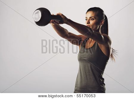 Attractive Female Doing Kettle Bell Exercise poster