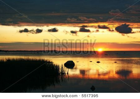 Cloudy Sunrise On The Sea