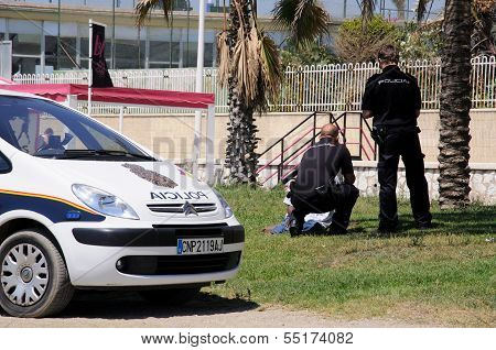 Police officers talking to vagrant, Malaga, Spain.