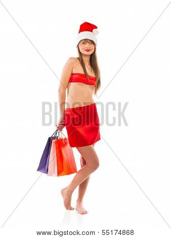 Beautiful Santa Christmas Girl With Shopping Bags On White