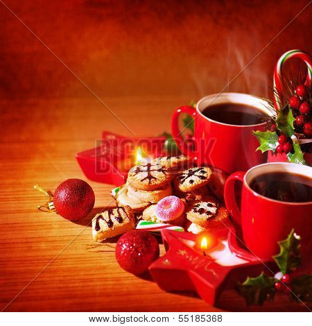 Closeup photo of festive Christmastime still life, tasty dessert, homemade cookie with mug of hot coffee, Christmas celebration concept
