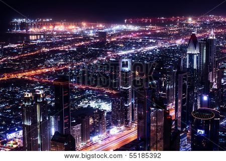 Dubai city at night, UAE, beautiful bird eye view on glowing downtown, panoramic cityscape, luxury Arabic buildings, travel and tourism concept