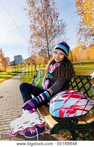 School Girl Putting On Roller Blades