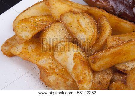 Golden Fried Crisp Potato Wedges.
