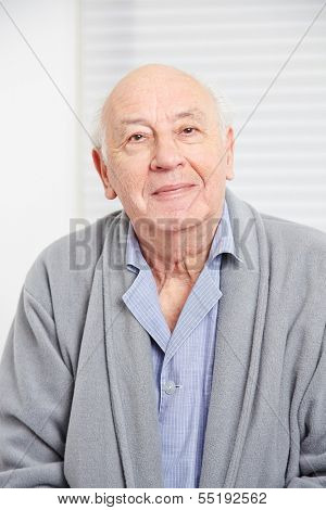 Face of an smiling old man in a retirement home
