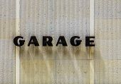 Garage Sign At House Facade