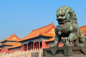 foto of emperor  - Lion statue and historical architecture in Forbidden City in Beijing - JPG