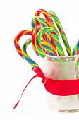 pic of testis  - Testy Christmas candy canes on white background - JPG
