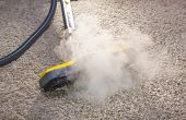 stock photo of sanitation  - Using dry steam cleaner to sanitize floor carpet - JPG
