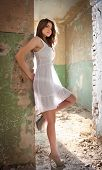 stock photo of gypsy  - beautiful girl posing fashion near an old wall - JPG