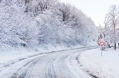 stock photo of slippery-roads  - Snow tracks on a country road and 60 mph - JPG