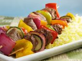 picture of kababs  - Juicy beef kabobs with bell peppers onions zucchini and cherry tomatoes - JPG