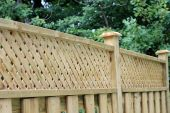 foto of wooden fence  - Wooden fence with a lattice screen for privacy - JPG