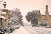 stock photo of cold-weather  - Cotswold high street in wintertime - JPG