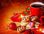 Christmas sweets still life on wooden table in cozy cafe, red cup with coffee, homemade gingerbread,