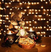 Image of traditional x-mas toys on glowing lights background, Christmastime decorations still life,