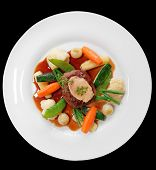 foto of marrow  - Tenderloin steak with vegetables and bone marrow isolated on black background - JPG