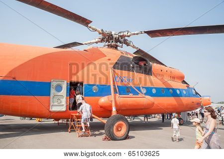 Visitors of air show explore the MI-6A helicopter