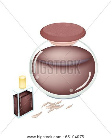 A Bottle And Jar Of Thymelaeaceae Perfume