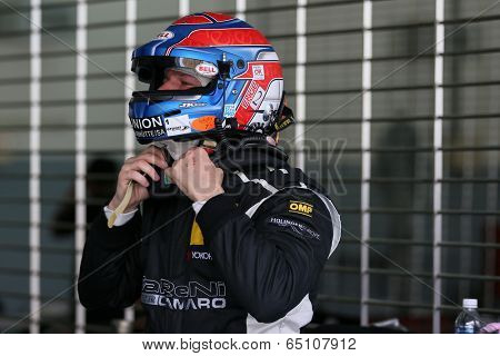 SEPANG, MALAYSIA - MAY 11, 2014: World renown racing driver Tomas Enge of Reiter Vattana RPM Motorsport suits up before the Thailand Supercar GT3 race at the Sepang International Circuit, Malaysia.