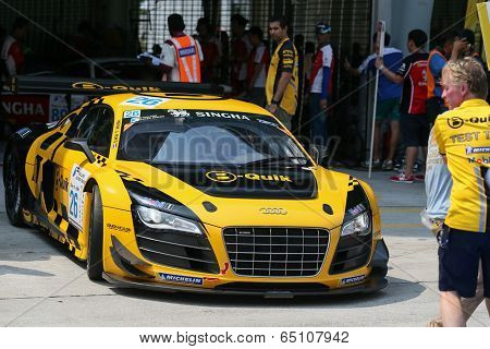 SEPANG, MALAYSIA - MAY 11, 2014: Driver Henk J. Kiks in an Audi R8 LNS car leaves for the tracks to start the Thailand Supercar GTM race at the Sepang International Circuit, Malaysia.