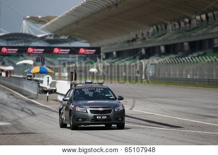 SEPANG, MALAYSIA - MAY 11, 2014: The Sepang International Circuit Safety Car enters the track at the end of the race at the Thailand Super Series Round 1 held in Sepang Malaysia.
