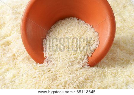 pick up of rice with a ceramic bowl
