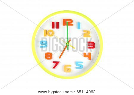 Colorful Clock In Telling Time Of Seven O'clock.