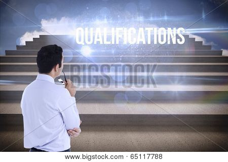 The word qualifications and businessman holding glasses against steps against blue sky