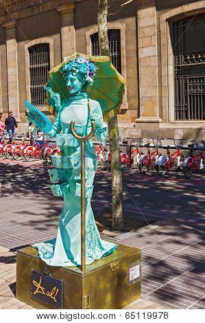 Street Performer Imitating Statue At La Ramblas In Barcelona, Spain