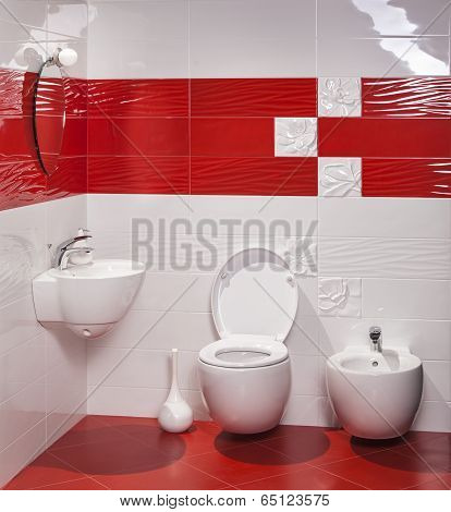 Interior Of Modern Bathroom With Sink And Toilet And Bidet