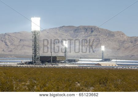 IVANPAH, CALIFORNIA - May 14, 2014:  Three glowing white hot towers at the newly operational 392 megawatt Ivanpah solar thermal power plant in California's Mojave desert.