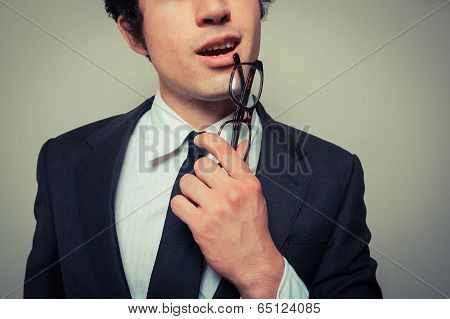 Thoughtful Businessman With Glasses