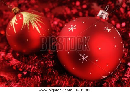 Christmas balls over red background