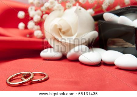 Wedding Rings And  Favors On Elegant  Fabric