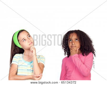 Two pensive little girl isolated on a white background