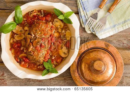 Juicy Meatloaf In A Casserole Served With Clean Napkin And Forks On A Rustic Table