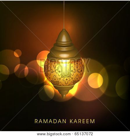 Illuminated golden arabic lamp or lantern on shiny brown background, creative greeting card design for holy month of Ramadan Kareem.