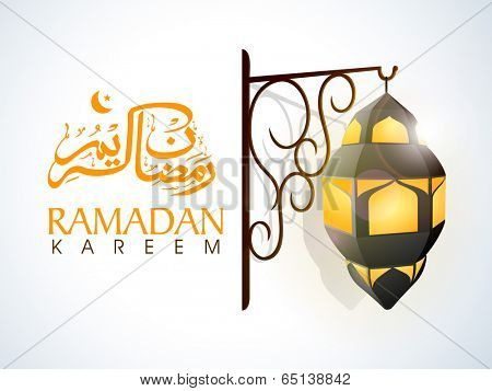 Arabic Islamic calligraphy of text Ramadan Kareem and illuminate stylish lamp hanging on floral decorated stand on grey background.