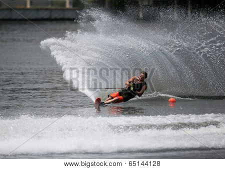 PUTRAJAYA, MALAYSIA - APRIL 26, 2014: Jarno de Lacy of New Zealand rides the waves at the Slalom Open event at the Putrajaya Nautique Ski & Wake Championship 2014.