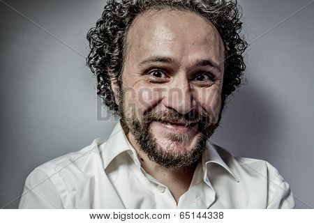 derision, man with intense expression, white shirt