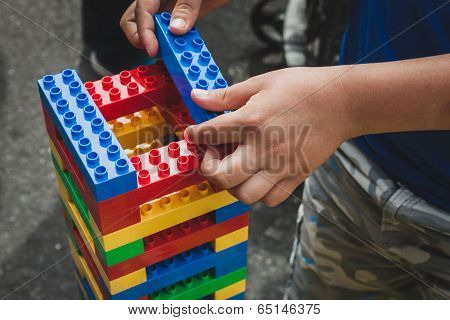 Child Plays With Lego Bricks In Milan, Italy