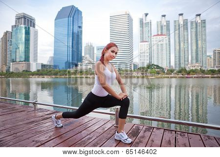 Young Woman Doing Stretching Exercise