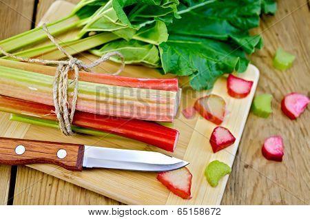 Rhubarb Cut With A Leaf On Board