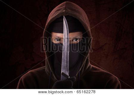 A Man Holding Sharp Knife
