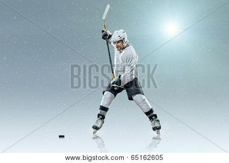 Ice hockey player on the ice and light effects