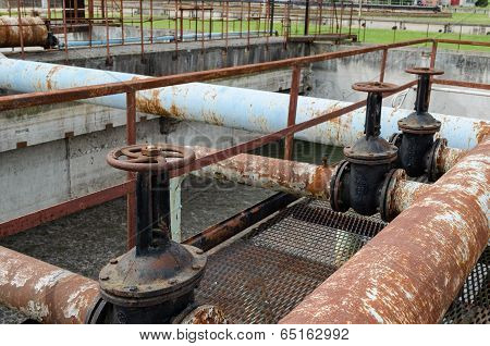 Rusty Big Tap And Pipes And Water Treatment Liquid