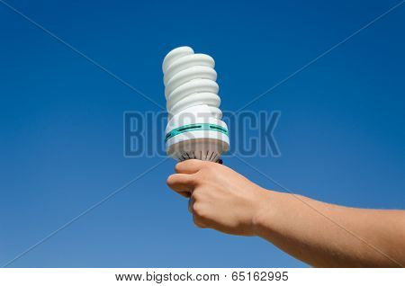 Hand Hold Ecology Save Bulb On Blue Sky Background