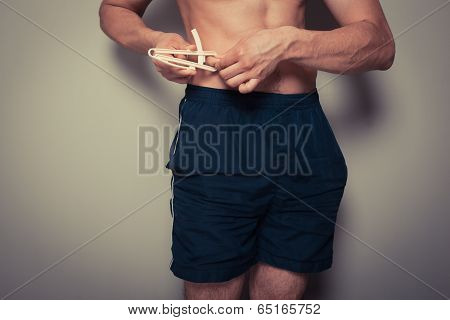 Young Man Measuring His Body Fat