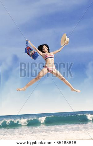 Excited Girl Jumping At A Beautiful Beach